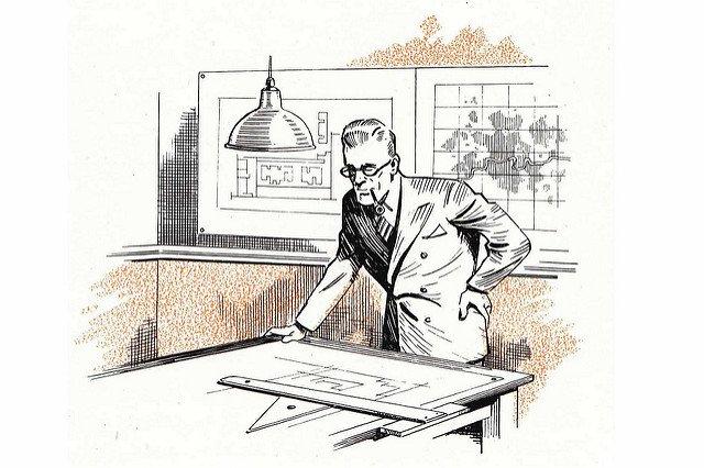 Un architecte en plein travail sur ses plans.